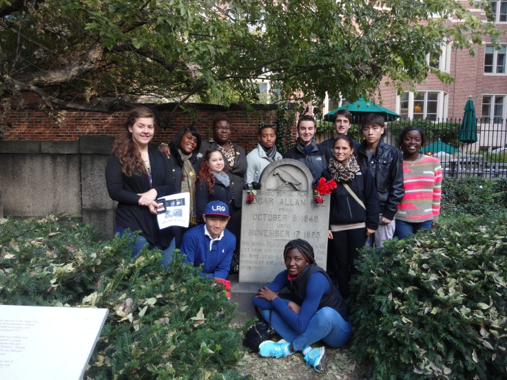 Professor Oakman and her ENGL 101 students at the grave of Edgar Allan Poe