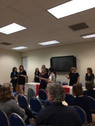 Sigma Tau Delta inductees do the pledge.