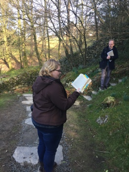 Taylor reads from Dorothy's Grasmere journal in the garden of Dove Cottage. The Wordsworth Trust curator, Jeff Cowton, who led most of the week's activities stands on Wordsworth's steps.