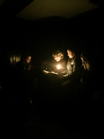 """Taylor reads Wordsworth's poem """"Nutting"""" by candlelight in Dove Cottage, where Wordsworth and his sister, Dorothy, lived from 1799–1808."""