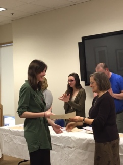 Taylor Blum receives her certificate from Dr. Ilene Lieberman, Director of the Honors Program in General Education