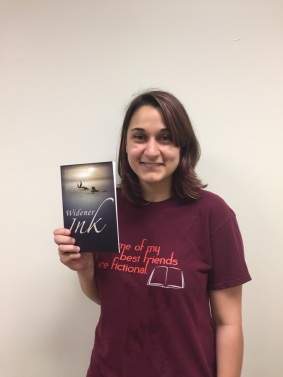 Editor Haley Poluchuk with this year's issue of Widener Ink